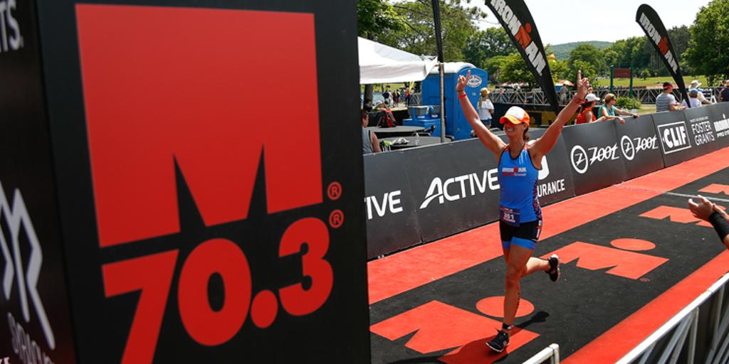Triathlete crossing finish line