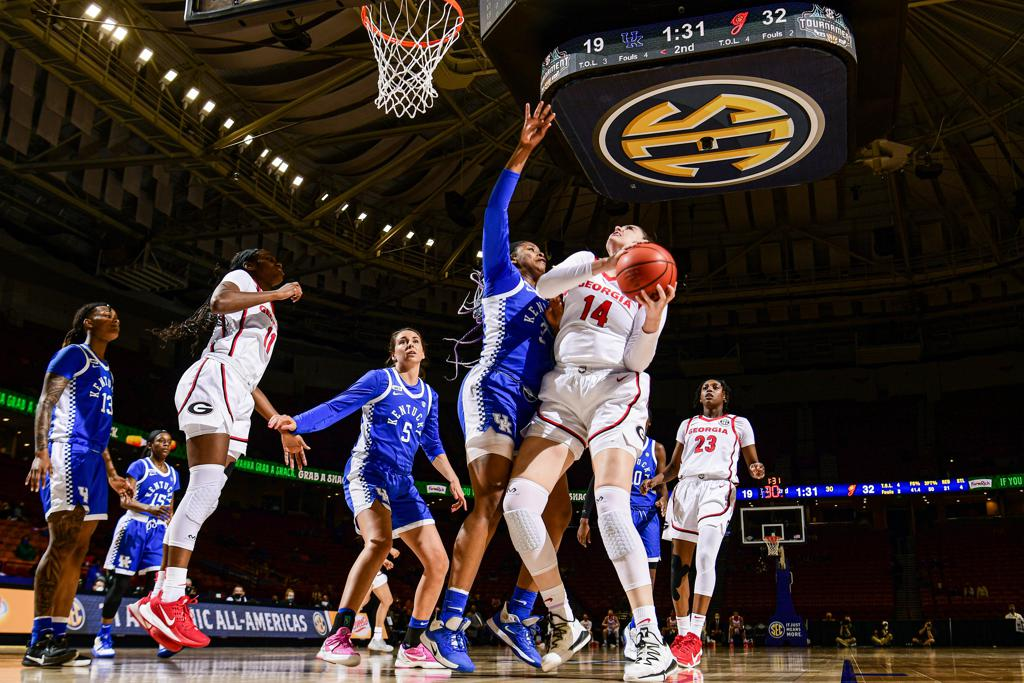 2021 SEC Women's Basketball Tournament Georgia's Jenna Staiti (14) looks for a shot while being guarded by Kentucky's Keke McKinney (3)