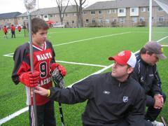 Coach preparing a longpole for a Field Lacrosse game