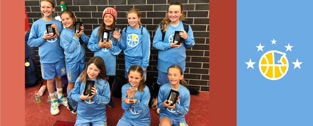 Minneapolis Lakers Girls 5th Grade Blue pose with their trophies after earning 3rd place at the Stillwater Big East tournament in Stillwater, MN