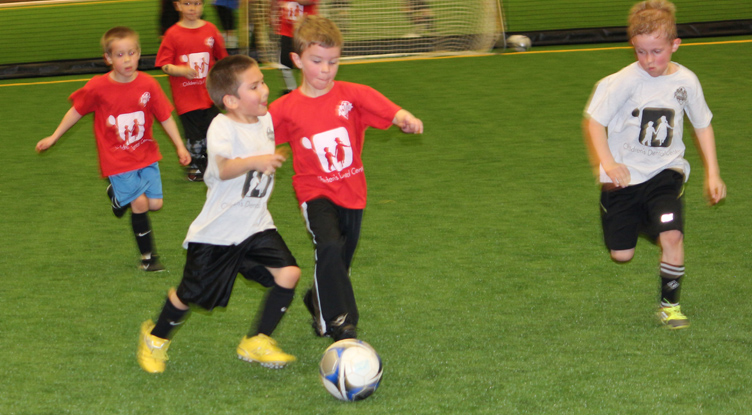 Sanford Sports soccer kids playing indoors