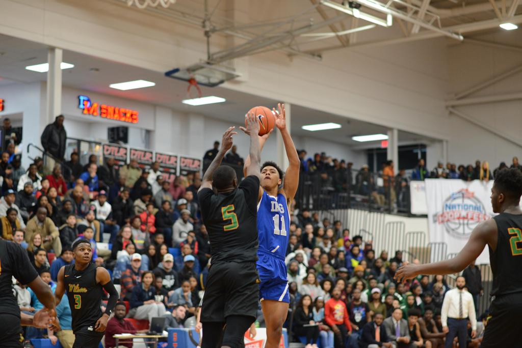 IMG's #11 Jaden Springer shoots over #5 Jay Heath Jr. of Woodrow Wilson