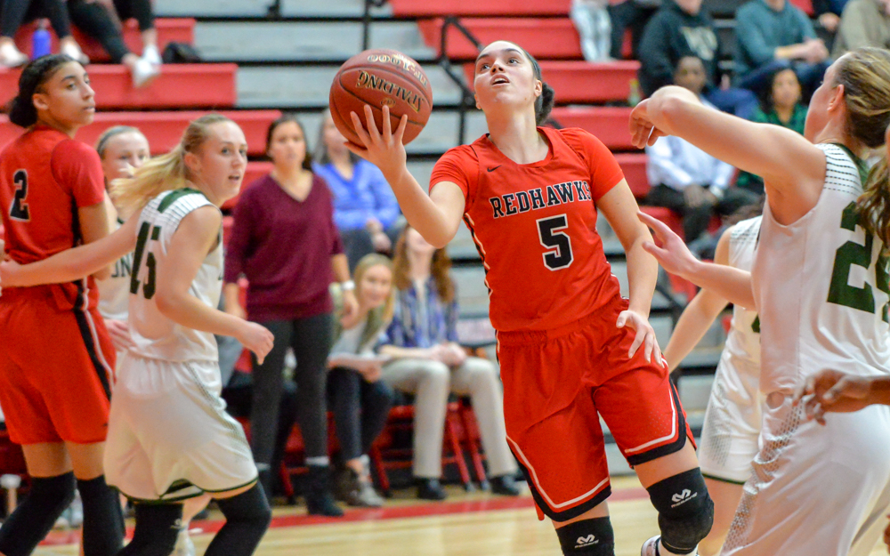 Minnehaha Academy junior Mia Curtis (5) goes for a layup Friday night at home. She had 18 points on the evening, powering the Redhawks past the Beacons 74-57.  Photo by Earl J. Ebensteiner, SportsEngine