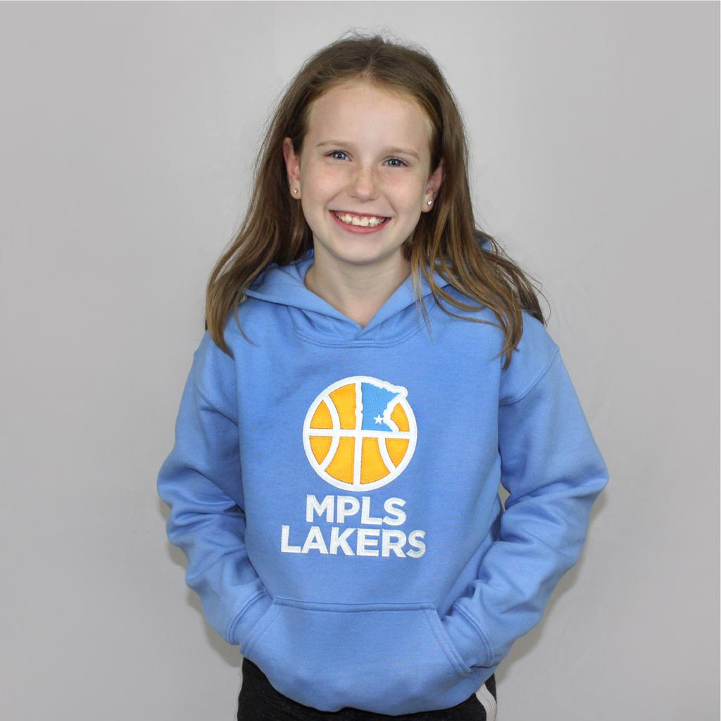 Young girl wearing Blue Hoodie with Tackle Twill Logo and Text