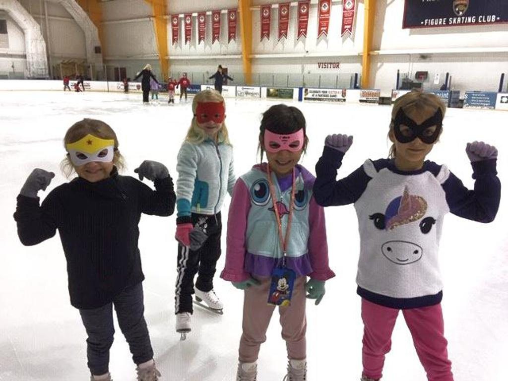 Children on the ice flexing
