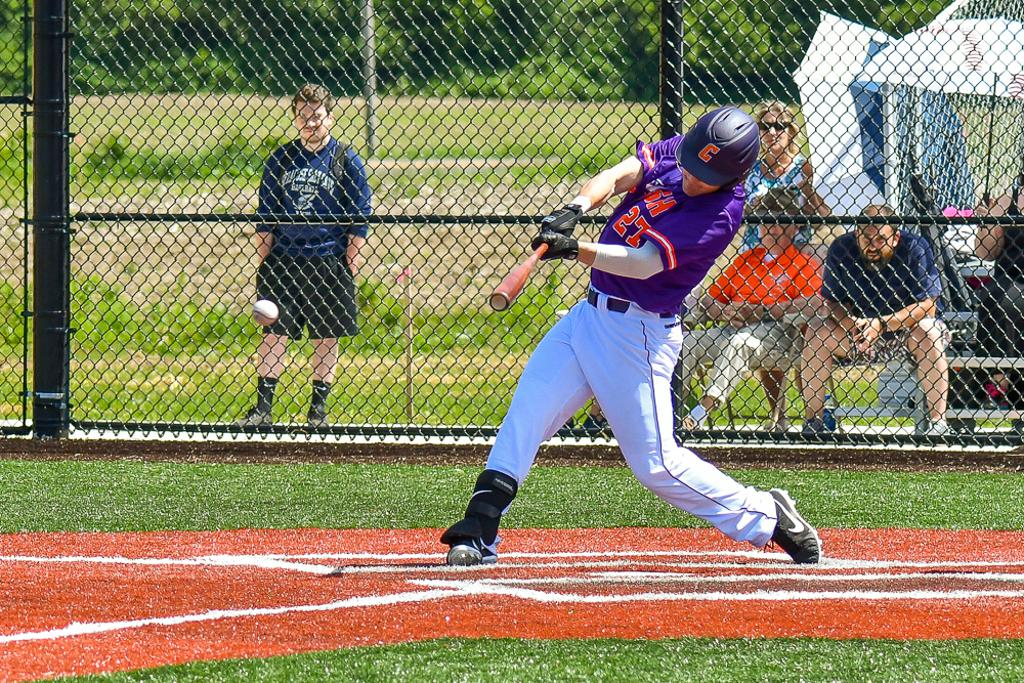 "Cortland Crush Brandon ""Buzz"" Shirley (27) hits the ball against  the Mansfield Destroyers at Gutchess Lumber Sports Complex in New York Collegiate Baseball League action at Cortland, New York on Saturday, June 8, 2019. Mansfield won 9-7."