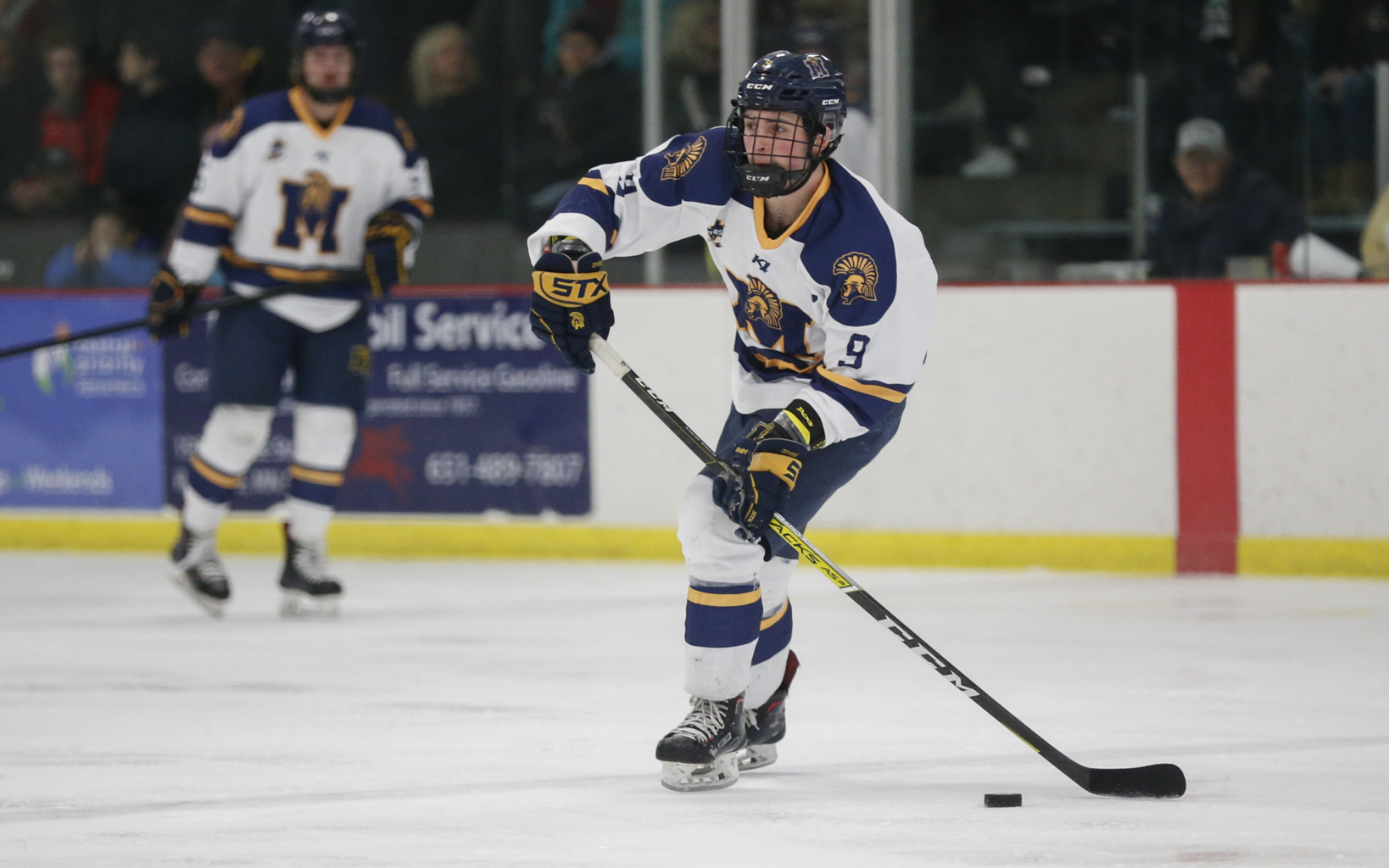Mahtomedi's Nikolai Dulak (9) sends a pass across the ice during Friday night's game against South St. Paul. Dulak had a goal and two assists in the Zephyrs' 5-1 victory over the Packers in Roseville. Photo by Jeff Lawler, SportsEngine