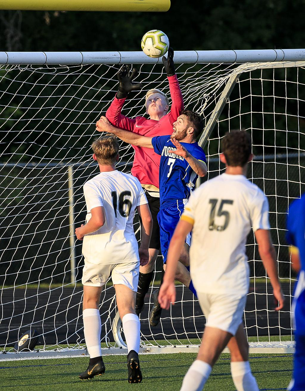 East Ridge goalkeeper Nick Wagner sends the ball away from the net late in the second half. Wagner's seven saves helped East Ridge beat Woodbury 3-1. Photo by Cheryl A. Myers, SportsEngine