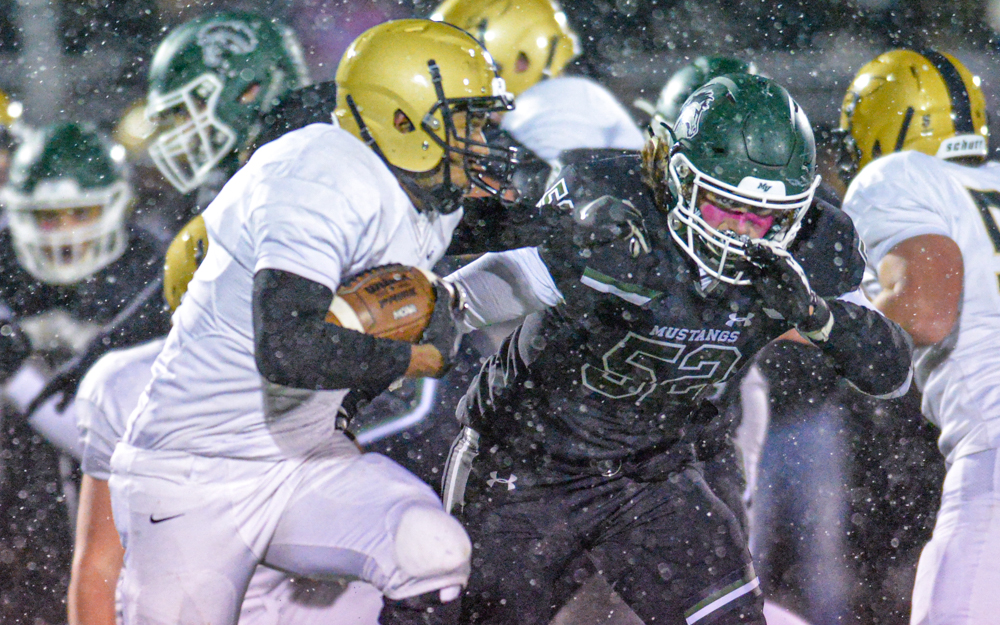East Ridge's KJ Moore carried the ball for three touchdowns in the first half Friday night helping his Raptors beat the Mustangs 41-40 in Mounds View. Photo by Earl J. Ebensteiner, SportsEngine