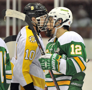 Miguel Fidler (12) of Edina shakes hands with Burnsville's Sam Rossini (10) at the end of the game. Photo by Katherine Matthews