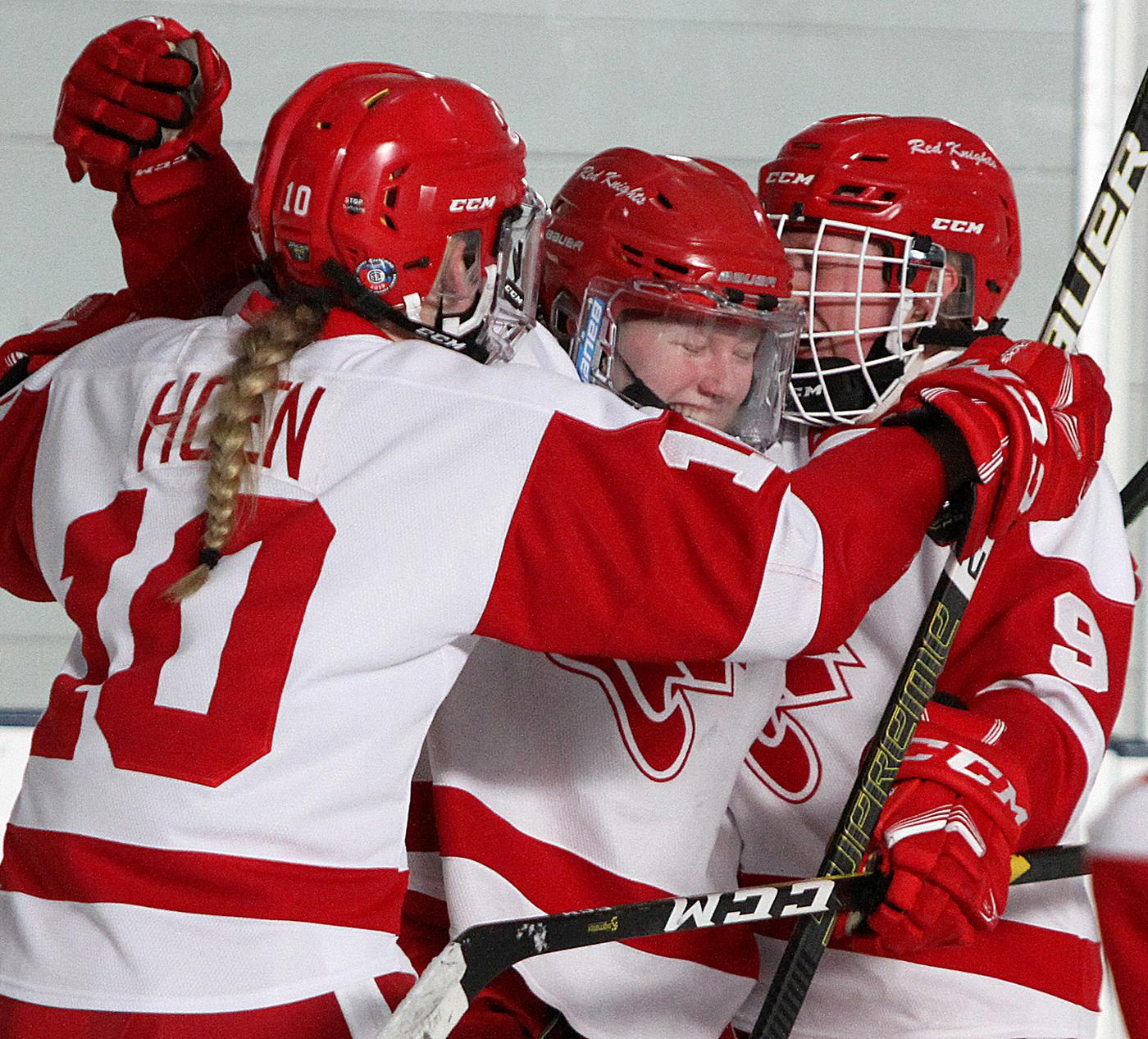 Benilde-St. Margaret's senior forward Olivia Haag is mobbed by teammates Emma Hoen (10) and Abby Hancock (9) after a second-period goal Thursday evening. Photo by Drew Herron, SportsEngine