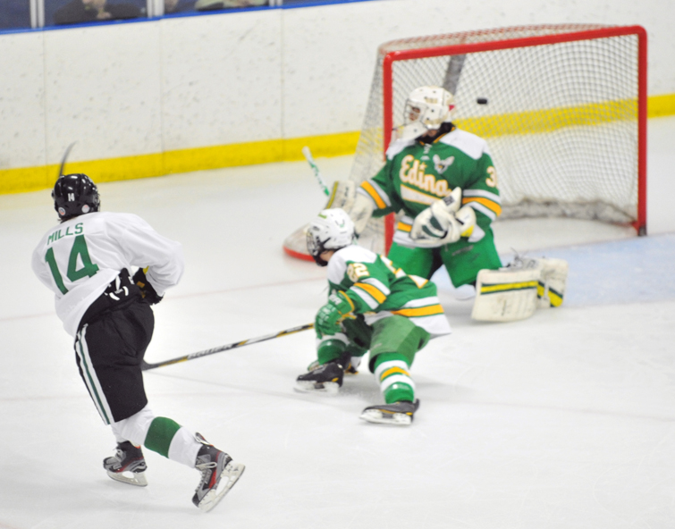 Zach Mills (14) of Hill-Murray scores a goal during the second period of the game. Photo by Katherine Matthews