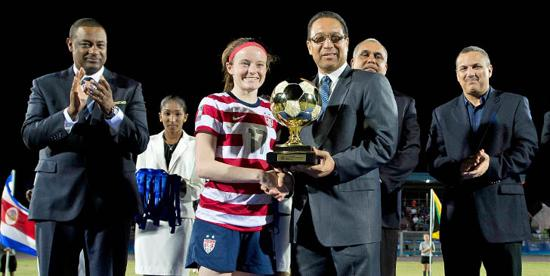 University of Wisconsin and U.S. midfielder Rose Lavelle receives the CONCACAF Under-20 Golden Ball from Alden McLaughlin, Premier of the Cayman Islands, on Sunday night. Photo courtesy of CONCACAF
