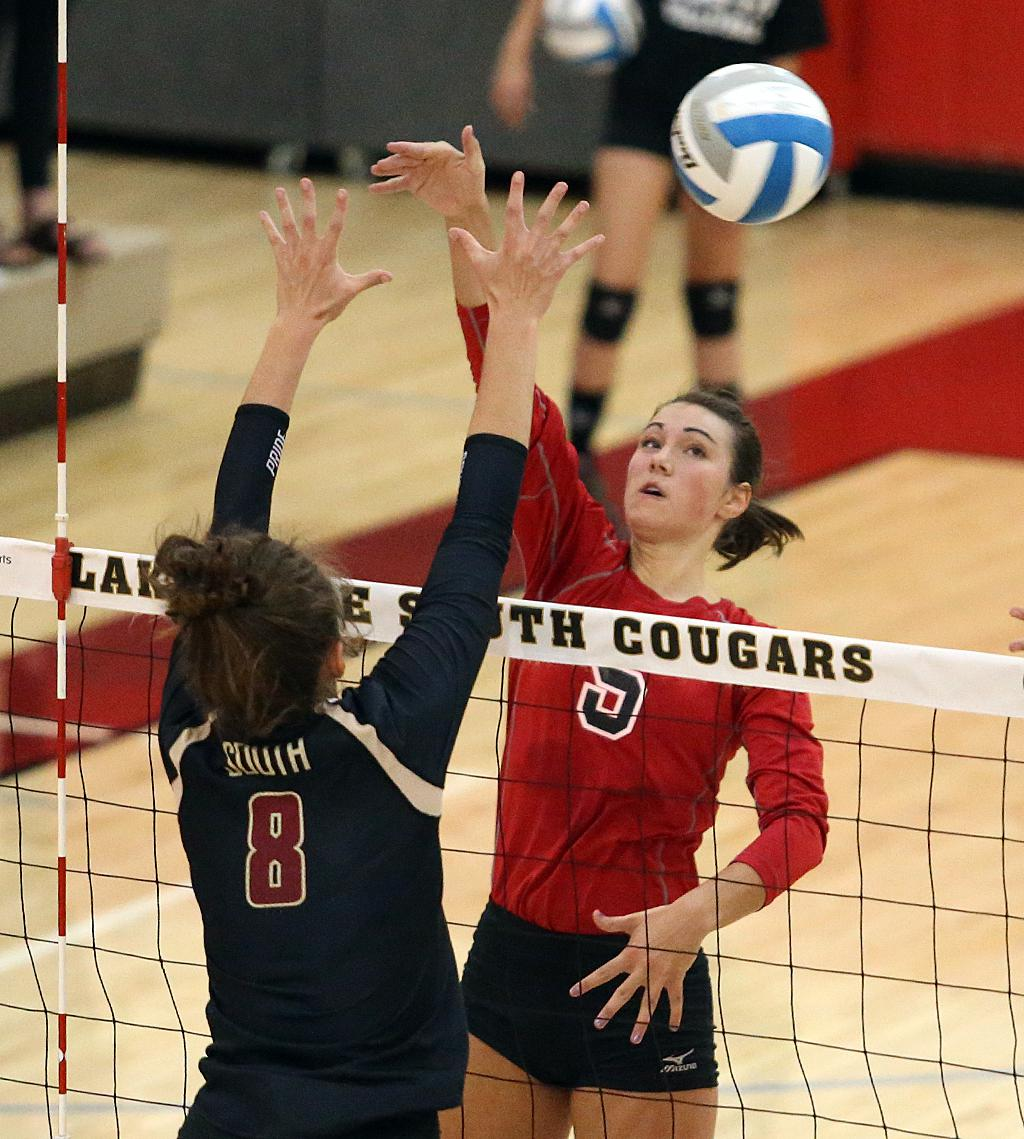 Lakeville North's Elizabeth Juhnke (5) sends the ball past defender Jasmine Mulvihill (8). Juhnke and teammate Macy Winter led the Panthers with 16 kills apiece. Photo by Cheryl Myers, SportsEngine