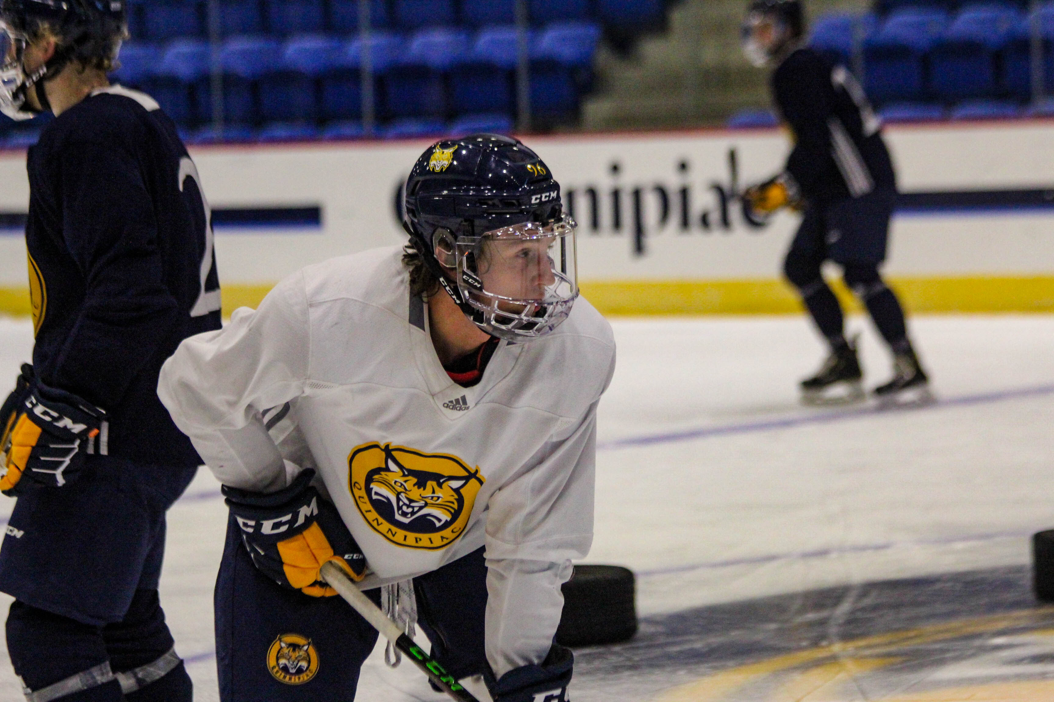 Colorado native Ty Smilanic leans on his stick at practice for Quinnipiac University. Photo courtesy of Quinnipiac University Athletics