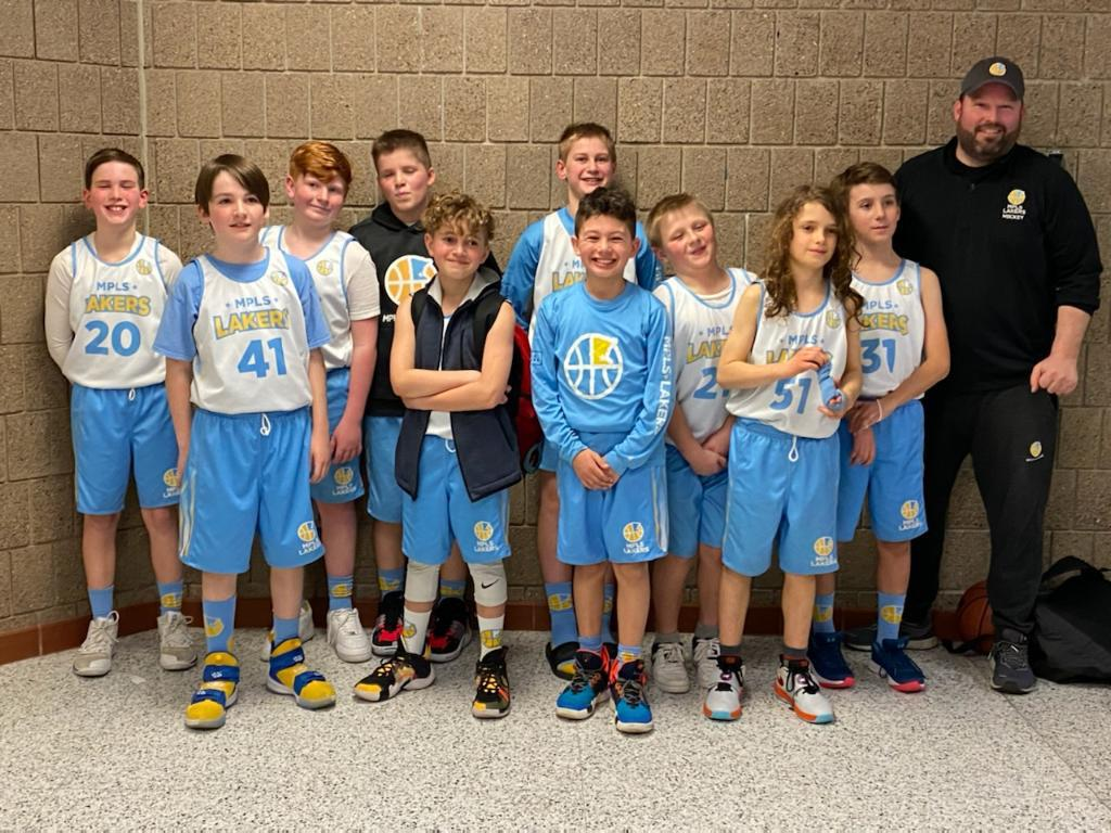 Mpls Lakers Youth Traveling Basketball Program Inc Boys 5th Grade Blue pose after taking Third Place at the Park Center Winter Shootout tournament in Brooklyn Park, MN