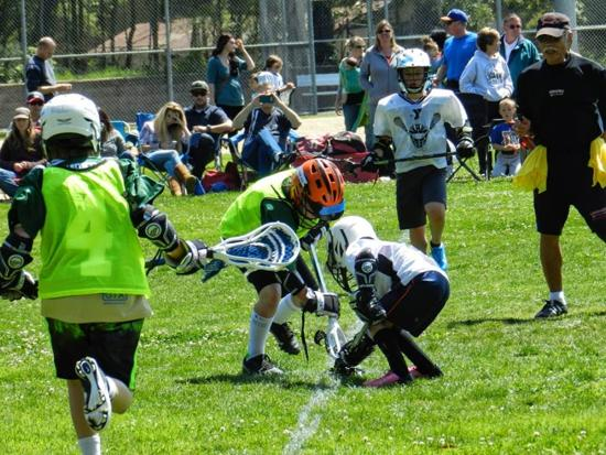 Face-Off on Taylor Field in the first weekend of youth lacrosse on the Central Coast