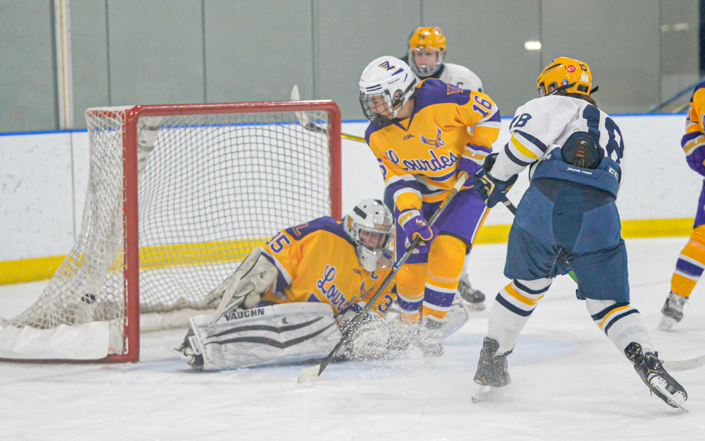 In the second period, Breck's Shae Messner scored the Mustangs' fourth goal Saturday afternoon. The Mustangs beat Rochester Lourdes 6-5. Photo by Earl J. Ebensteiner, SportsEngine
