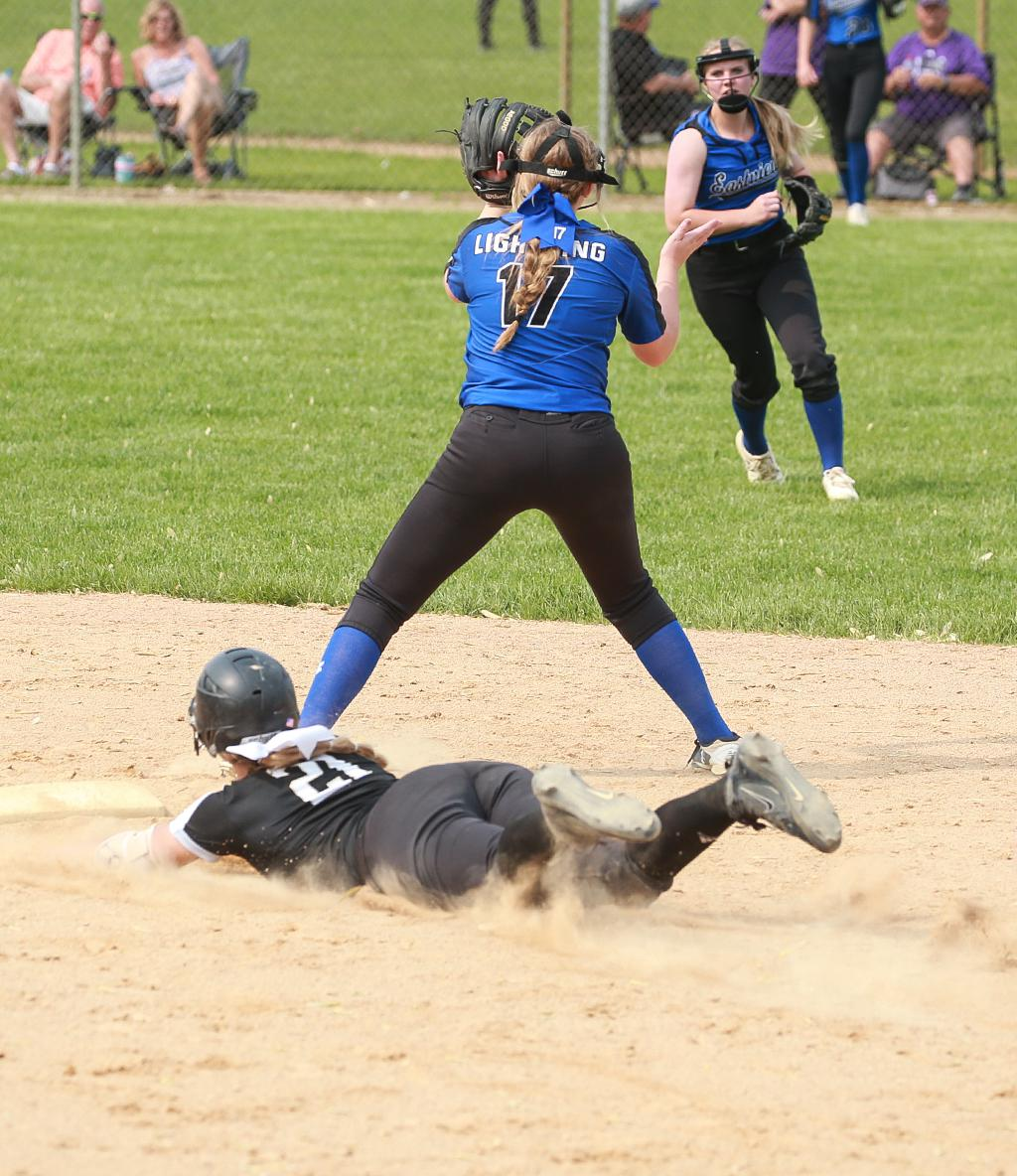 Sidney Zavoral (21) slides into second base on an RBI double in the bottom of the fifth inning, giving East Ridge a 5-4 lead. The Raptors beat Eastview 10-4 to clinch a spot in the Class 4A state tournament. Photo by Cheryl Myers, SportsEngine