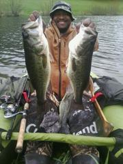 Fishing guide Cornelius Harris hoists two trophy bass