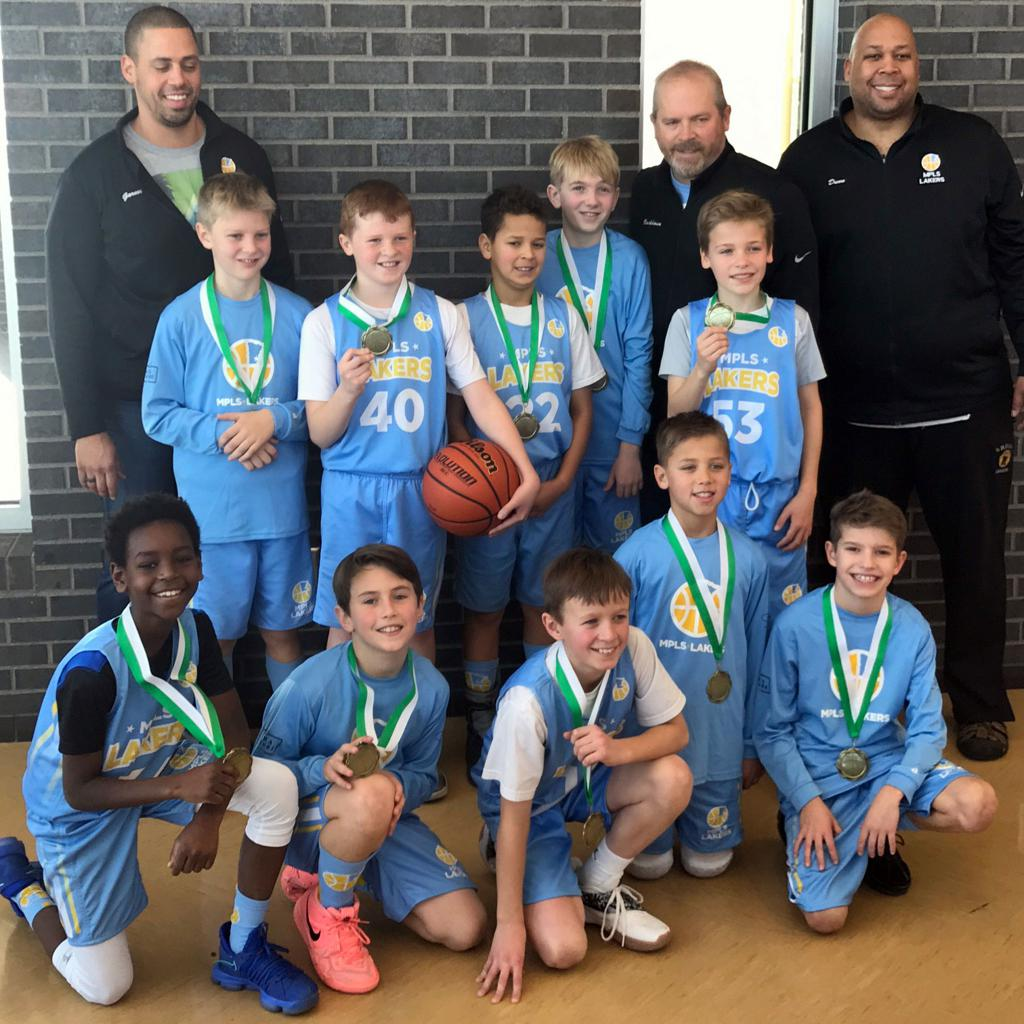 Boys 5th Grade Gold pose with their hardware after taking 1st at Rockford Showcase