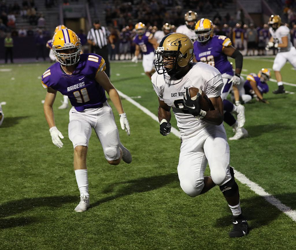 East Ridge running back KJ Moore (9) looks for an opening down the sideline on Friday night. Moore finished with 21 carries for 125 yards and a touchdown. Photo by Cheryl A. Myers, SportsEngine