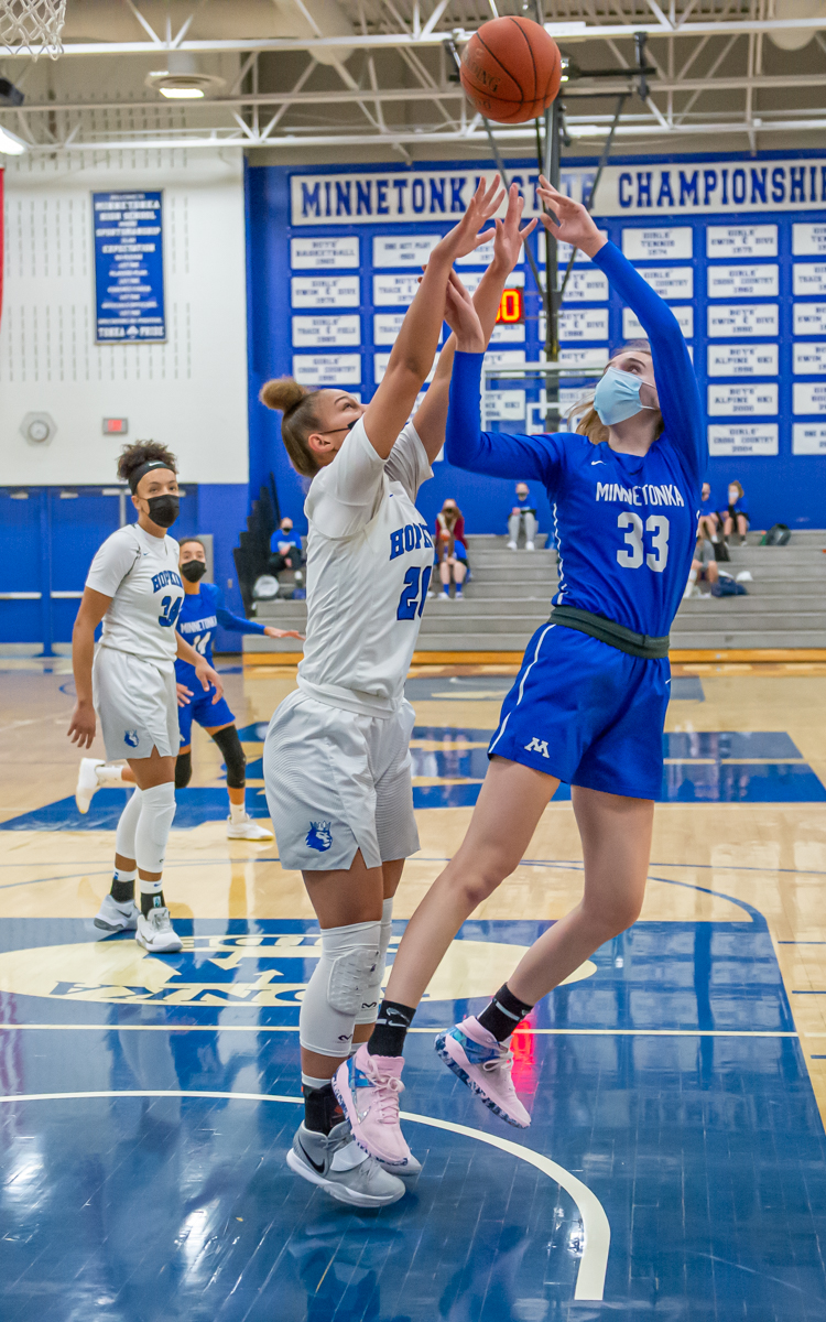 Minnetonka senior Sophie Haydon (33) goes for a basket during the first half of Thursday's Lake Conference home game against Hopkins, the top-ranked team in Class 4A. Photo by Earl J. Ebensteiner, SportsEngine