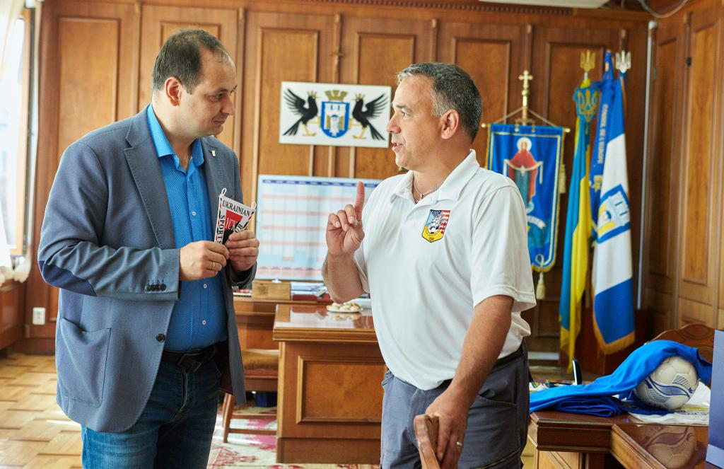Tour Manager & Organizer Michael A. Tomaszewsky, right side of picture, presenting YCK Banner to Mayor of Ivano Frankivsk -  Rusland Martsinkiv