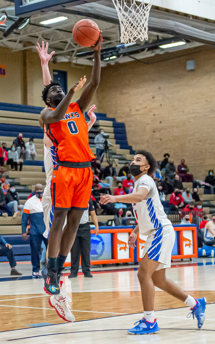 The Hawks' Davion Evans (0) had a game high 23 points in the Hawk's 84-57 win over the Falcons Friday night at home in the Class 4A, Section 6 semifinal. Photo by Earl J. Ebensteiner, SportsEngine