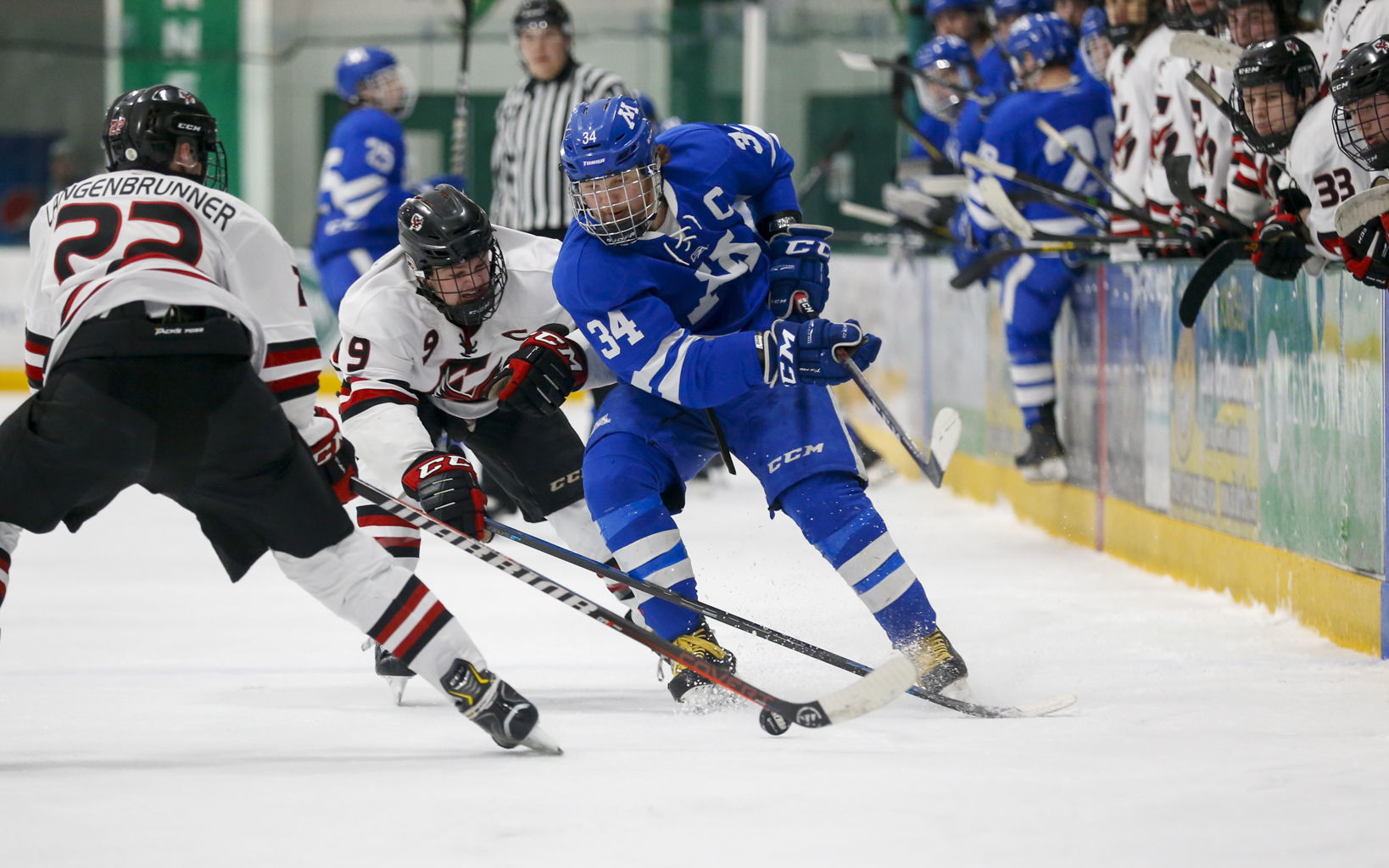 Minnetonka's Teddy Lagerback (34) battles two Eden Prairie defenders as he crosses into the offensive zone Saturday. Lagerback had the lone goal for the Skippers in their 6-1 loss to the Eagles at Braemar Arena. Photo by Jeff Lawler, SportsEngine