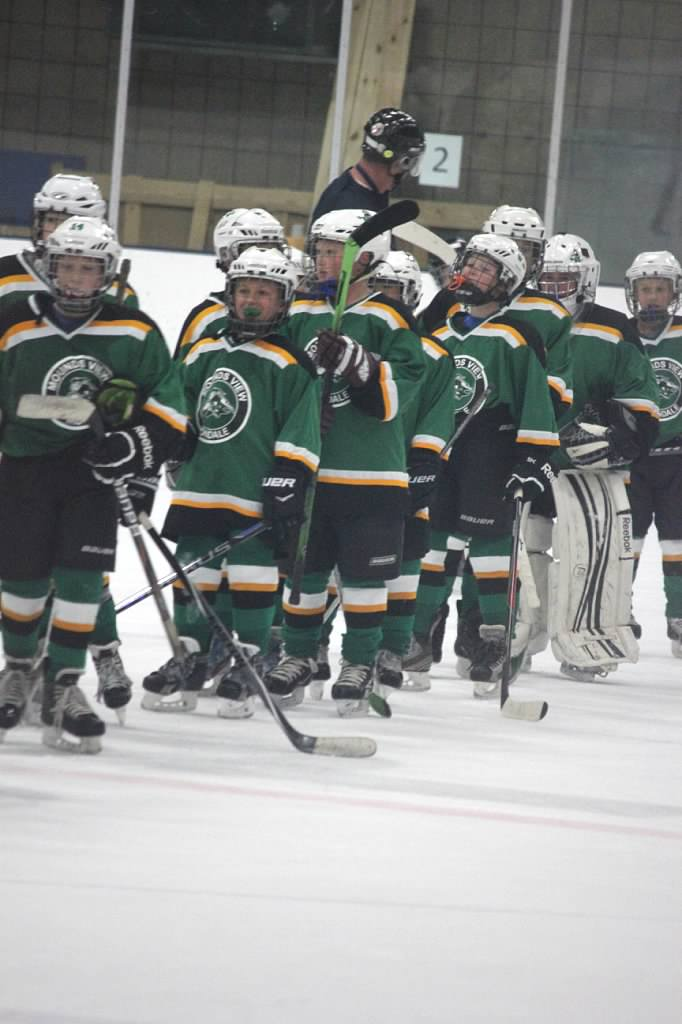 Squirt B White Team Trying On Their New Uniforms