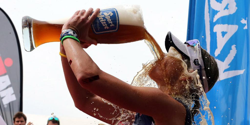 Triathlete celebrating with beer
