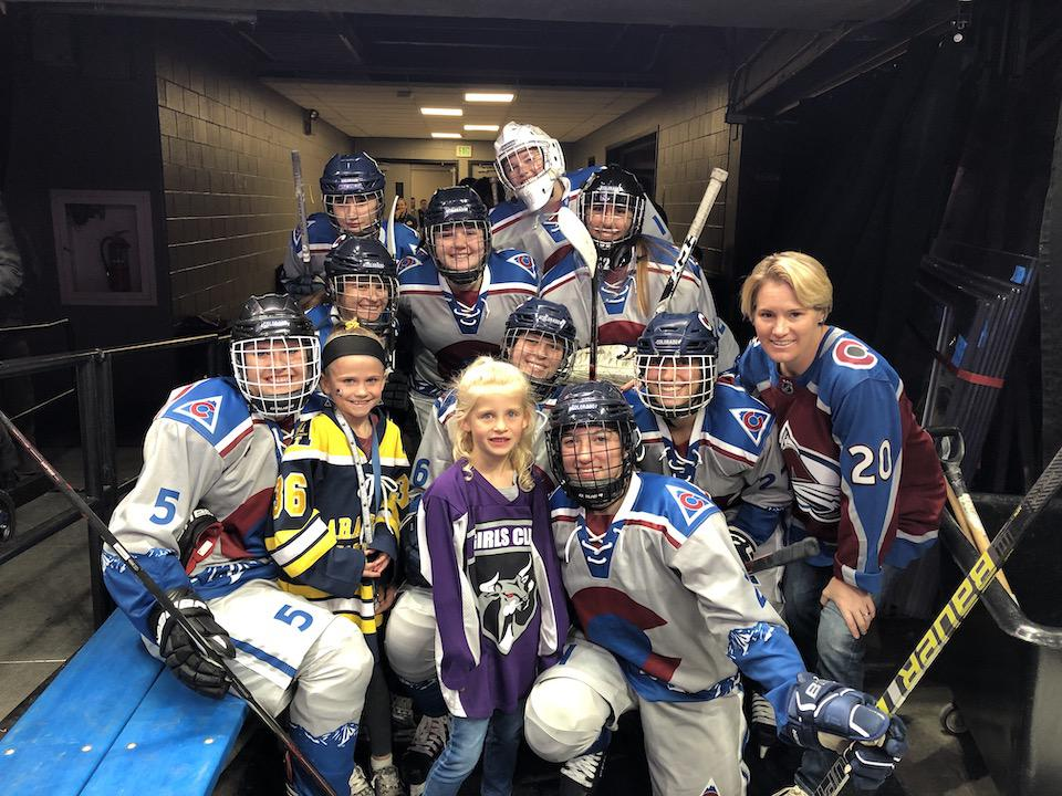 Michele Amidon (far right) with Team Colorado Tier 1 girls and local players the night she was announced female ambassador for the Colorado Avalanche. Photos courtesy of Michele Amidon