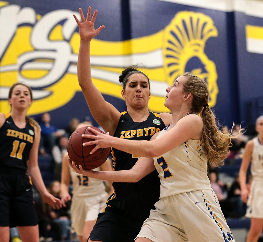 Mahtomedhi's Julia Salmen (4) guards Hastings' Shea Levos (2) in the first half. Salmen's 16 points led the Zephyrs to a 69-68 win in the final minute of the game on Friday night. Photo by Cheryl A. Myers, SportsEngine