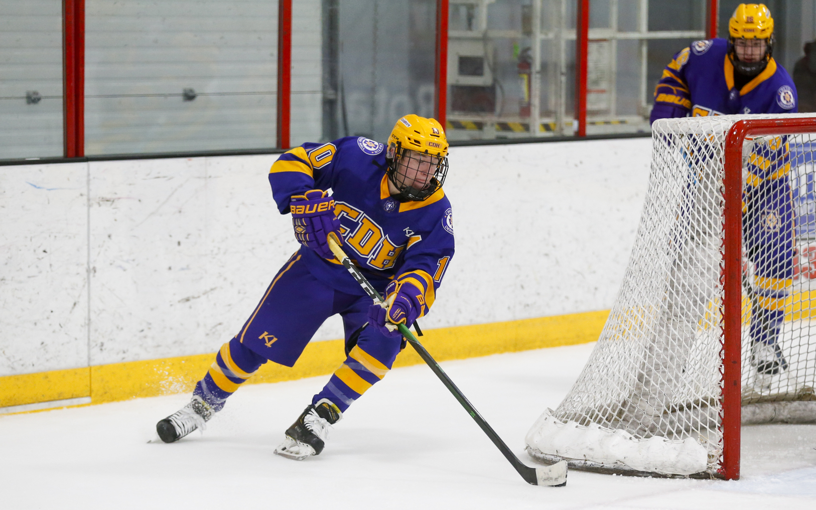Cretin-Derham Hall's Jack Nei (10) goes for a wraparound attempt against Stillwater Tuesday night. Nei had a goal for the Raiders in their 2-0 victory over the Ponies at the St. Croix Valley Rec Center. Photo by Jeff Lawler, SportsEngine
