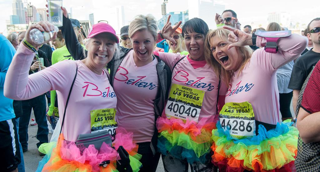 runners wearing colored tutus