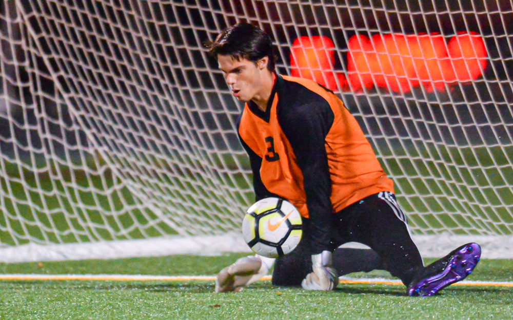 St. Paul Central's Henry Manerowski comes off the bench and stops an Abdirashid Mire penalty shot late in the second half in the Minutemen's a 2-1 win at home on a rainy Tuesday night. Photo by Earl J. Ebensteiner, SportsEngine