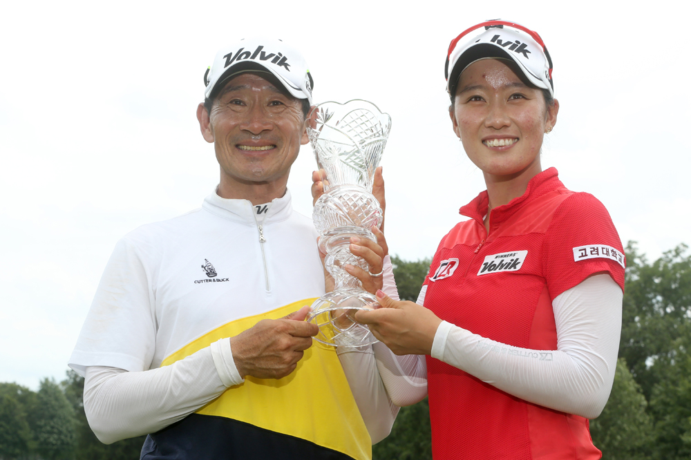 Ji Yeon Choi, who caddied for his daughter Chella Choi , holds the trophy after Chella's win in the 2015 Marathon Classic. BLADE/KATIE RAUSCH