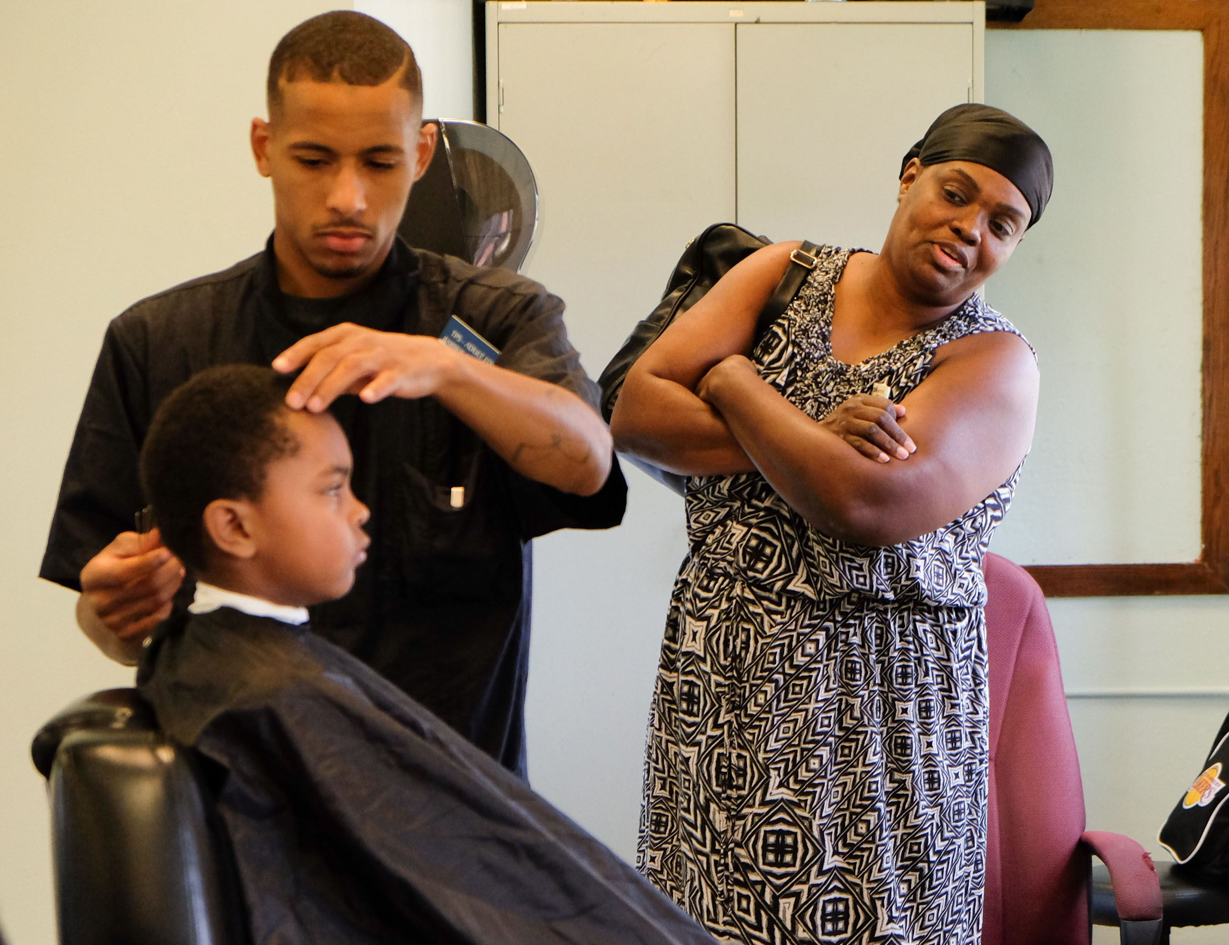 Haircut Coupons Toledo Ohio - Jamie winston of toledo right keeps an eye on grandson xavier winston 6 as he gets his haircut by kyle lightner of toledo