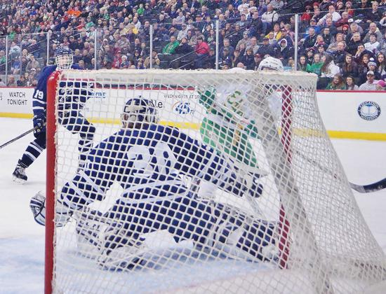 Edina's Garrett Wait watches his shot hit the back of the net. Photo credit: YHH.