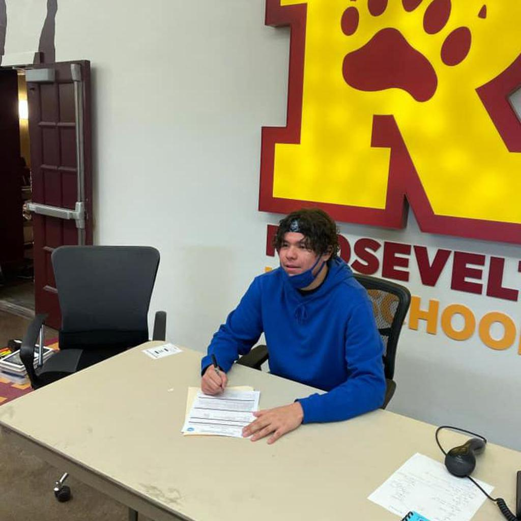 """Devan signing his letter of intent to play football at Itasca Community College. Minneapolis Roosevelt High School in South Minneapolis. Named after Theodore """"Teddy"""" Roosevelt.  #TeddyNation #TheVeltMpls #WeAreRoosevelt"""