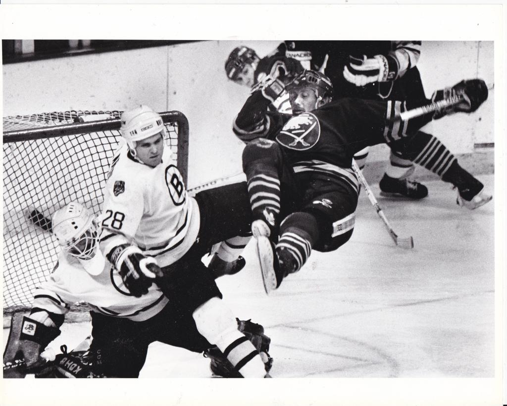Two of Mpls' Greatest...Ramsey and fellow Mpls Hall of Famer Reed Larson tangle in front of the net