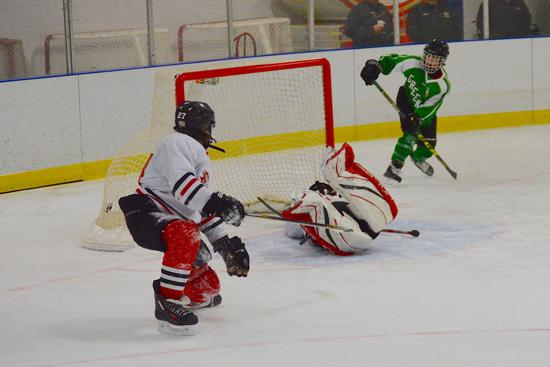 Greenway's Ben Troumbly scores for the Raider's Bantam A team Saturday. Credit: Peter Odney.