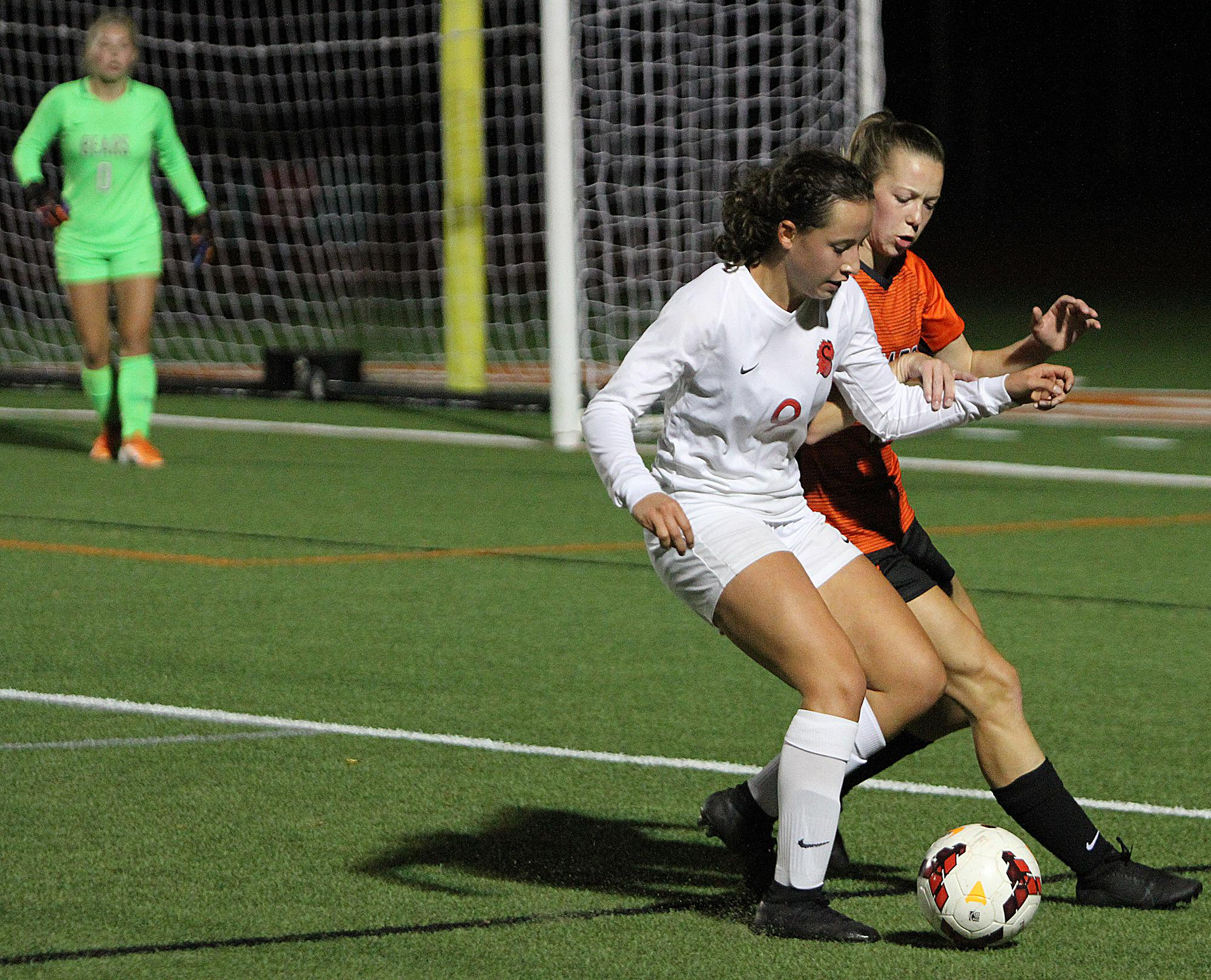 Stillwater's Marissa Bonilla battles for the ball along the sideline late in the second half. Stillwater shut out the host Bears for a 2-0 win that keeps them in first place atop the conference standings. Photo by Drew Herron, SportsEngine