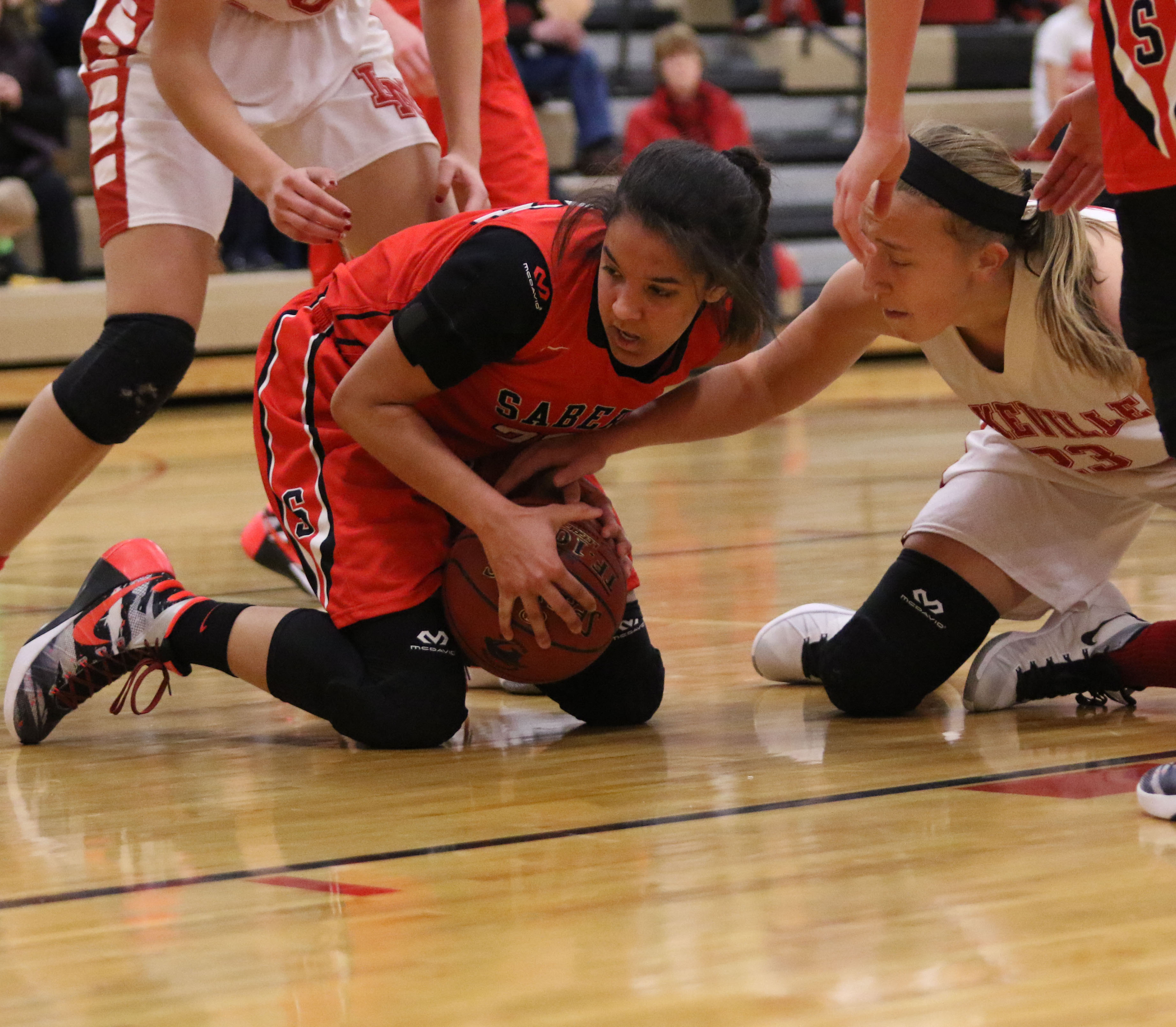 Shakopee's Mateya Hutton battles for the ball underneath as Lakeville North's Caitlyn Peterson attempts to regain possesion.  Photo by Cheryl Myers