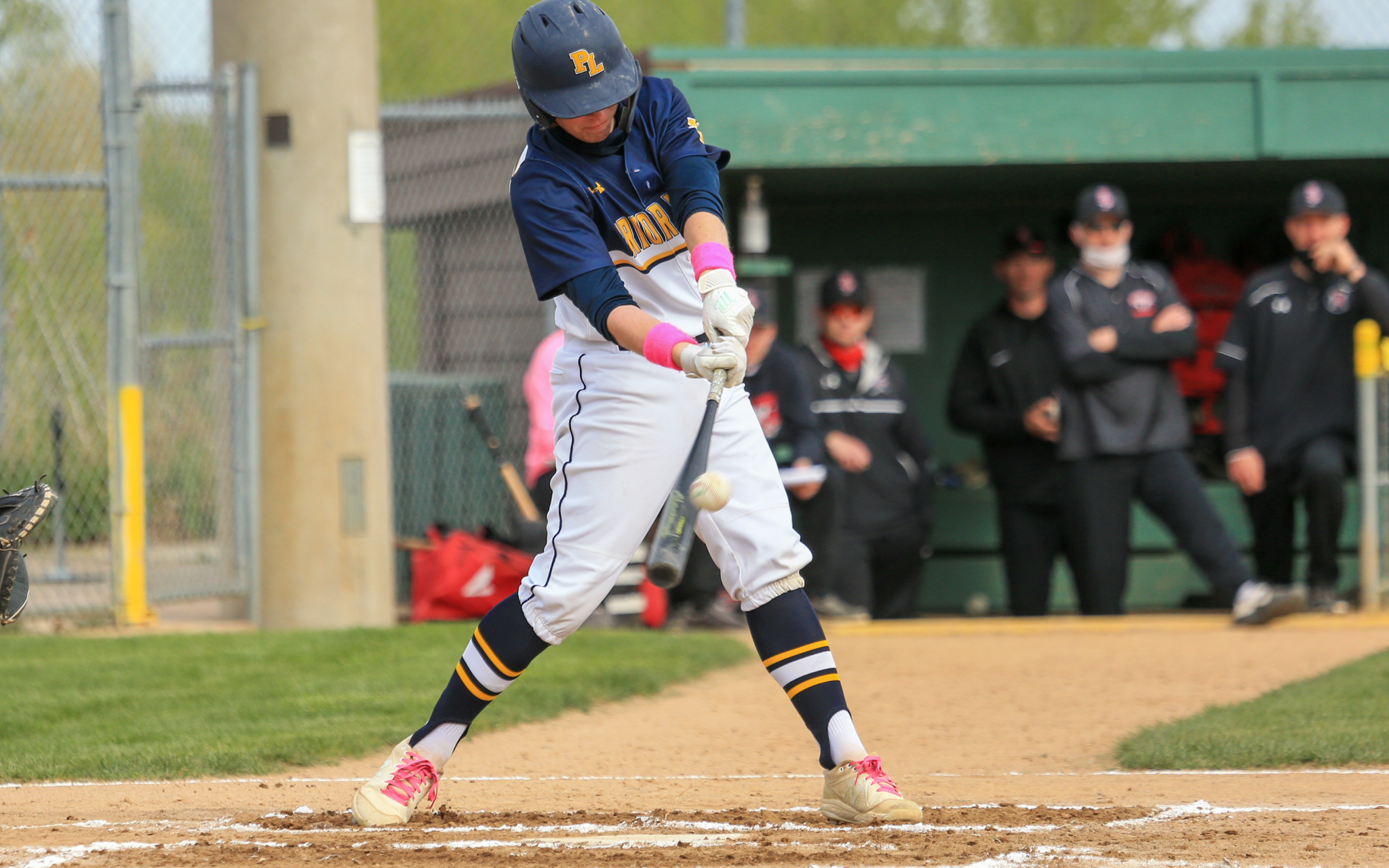 Prior Lake's Harry Fleek hits a two-run double in the bottom of the first inning against Belle Plaine Saturday. The Lakers defeated the Tigers 9-2 at Memorial Park in Prior Lake. Photo by Jeff Lawler, SportsEngine