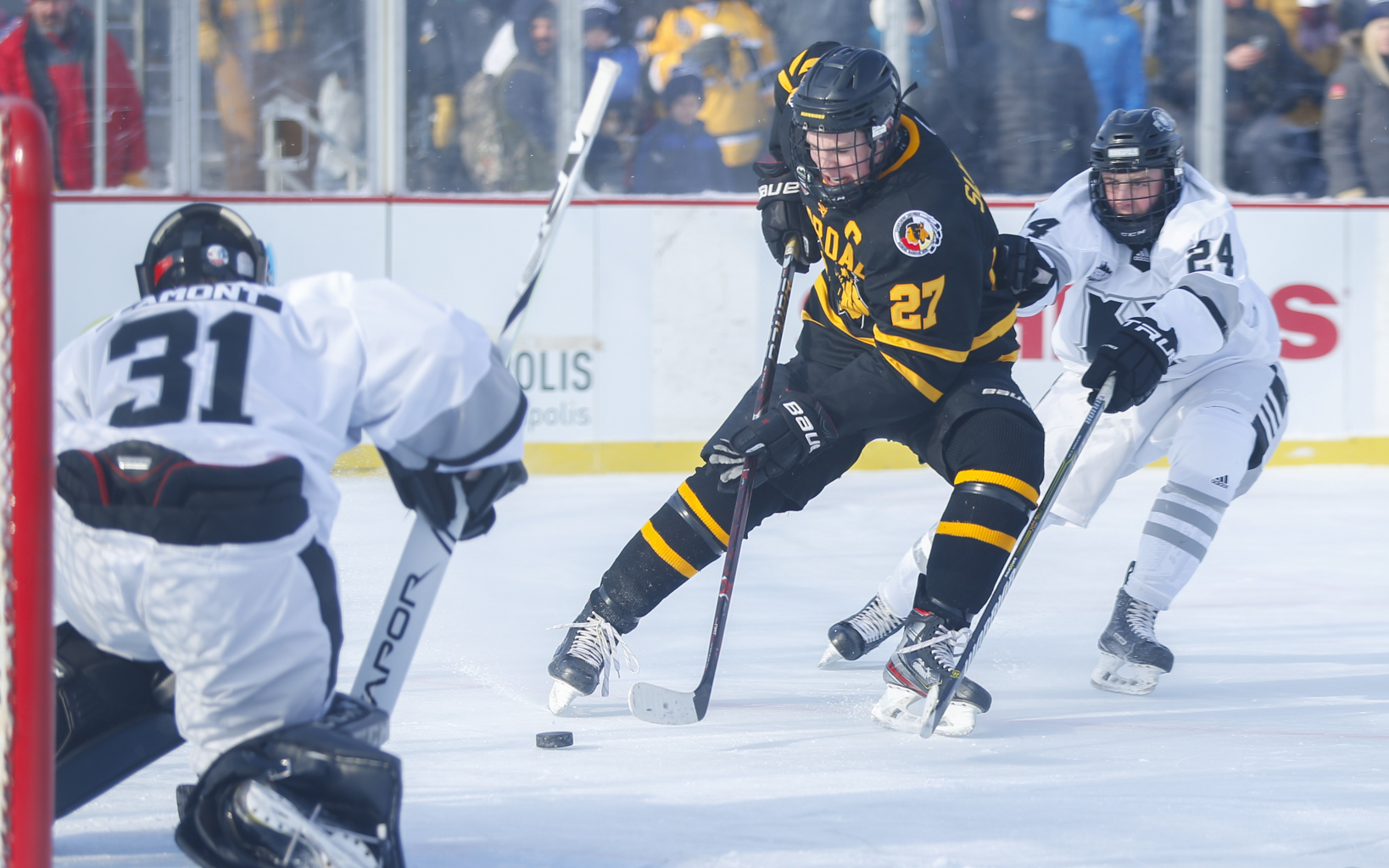 Warroad's Grant Slukynsky (27) crashes the net on a rush against Minneapolis Saturday morning. The Warriors defeated Minneapolis 5-1 in the early Hockey Day Minnesota game at Parade Stadium.  Photo by Jeff Lawler, SportsEngine