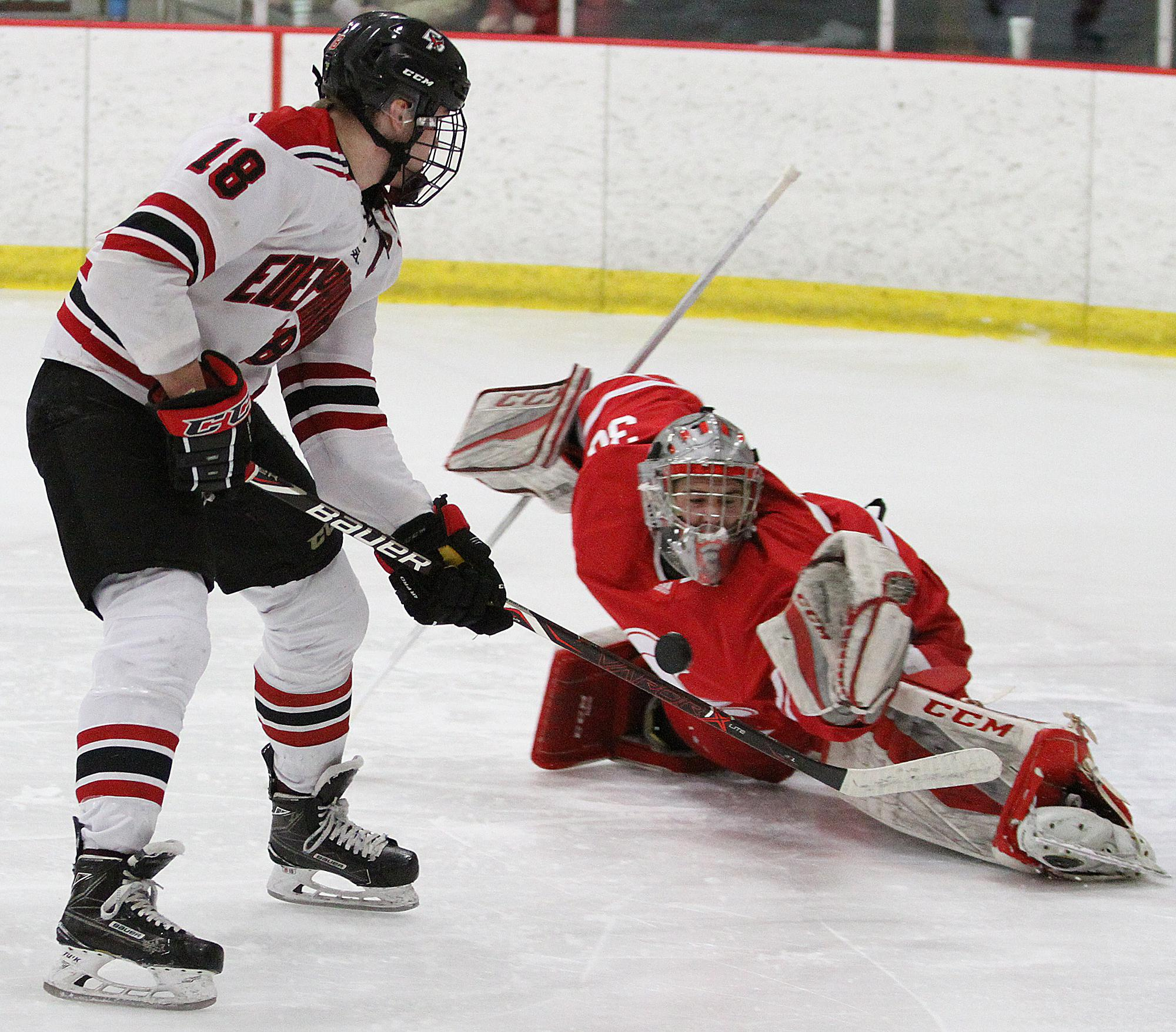 Benilde-St. Margaret's goalie Carson Limesand stops a scoring chance by Eden Prairie forward Jack Jensen during the first period Saturday evening at Eden Prairie Community Center.  Photo b
