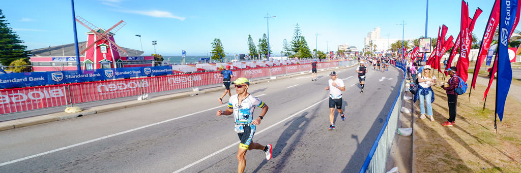 Athletes running along the Summerstrand and Humewood beach fronts while enjoying the support of spectators at IRONMAN African Championship
