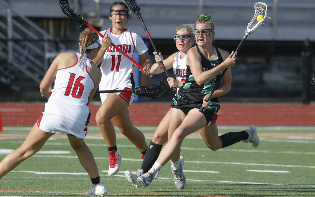 Hill-Murray's Lorelai VanGuilder tries to break through the Stillwater defense during the Section 4 championship Wednesday night. VanGuilder had four goals in the Pioneers' 13-8 loss to the Ponies. Photo by Jeff Lawler, SportsEngine